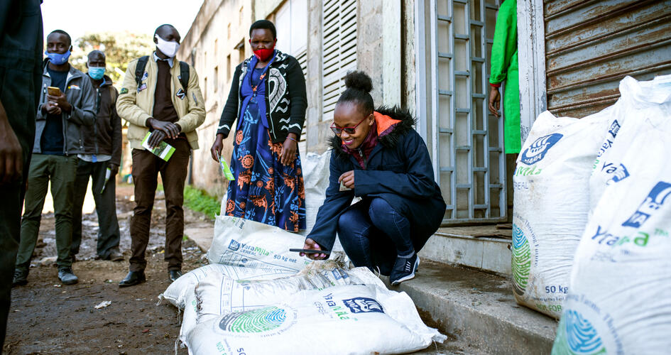 Woman scanning QR code on fertilizer bag