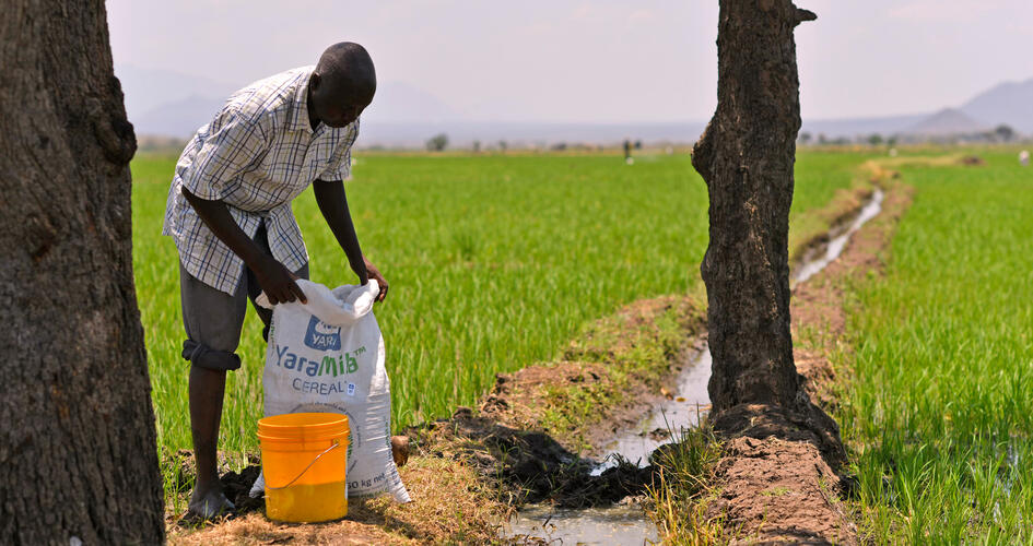 Jonathan Hudson Mujema with a Yara fertilizer bag in a farm