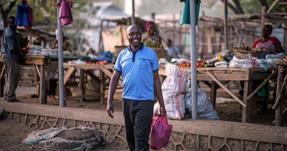 Jonathan Hudson Mujema in a market