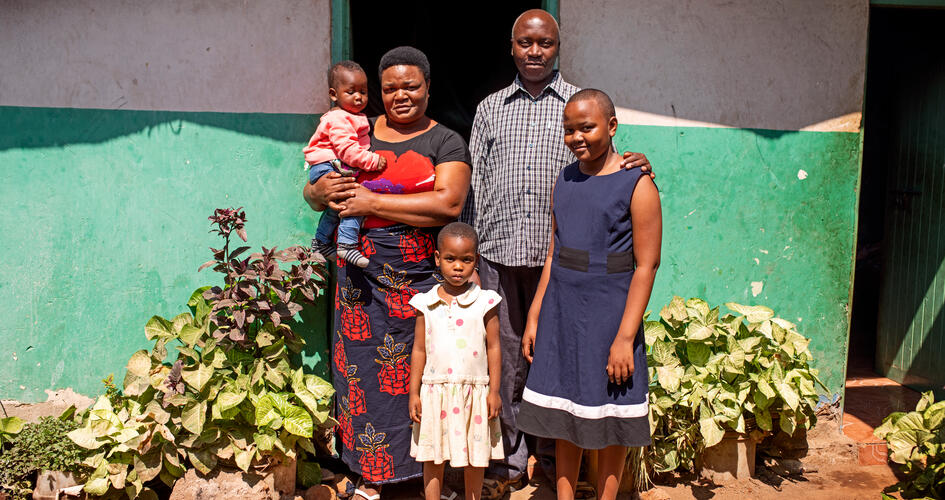 Jonathan Hudson Mujema with his family