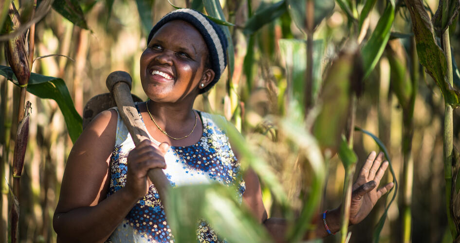 Female African farmer smiling and looking up