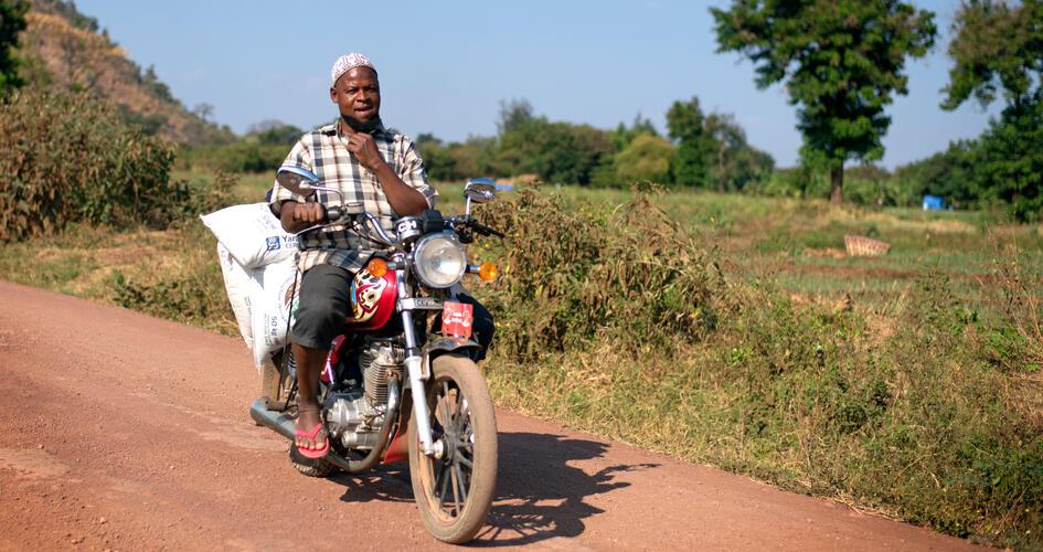 Elibariki Kimaro driving with Yara fertilizer bags on his motorbike